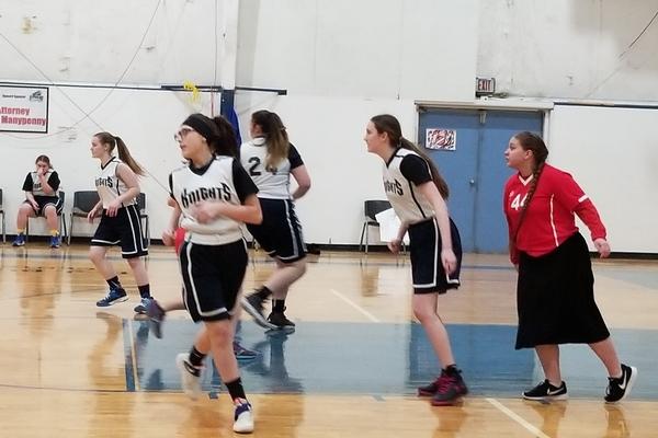 Girls running during basketball game